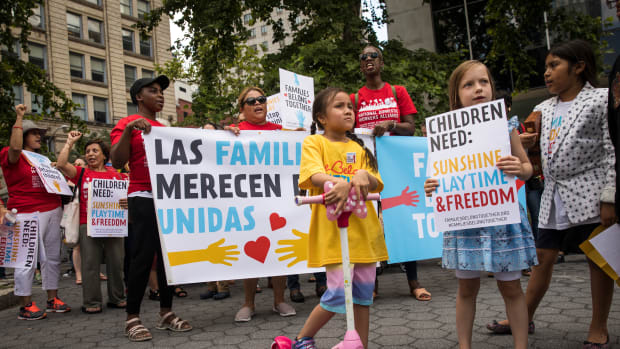 Activists, including childcare providers, parents, and their children, protest against the Trump administration's recent family detention and separation policies for migrants along the southern border, near the New York offices of U.S. Immigration and Customs Enforcement, on July 18th, 2018, in New York City.