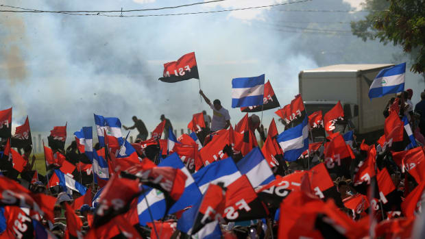 """Supporters of Nicaraguan President Daniel Ortega take part in the 39th Anniversary of the Sandinista Revolution at """"La Fe"""" square in Managua on July 19th, 2018."""