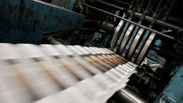 Freshly printed copies of the San Francisco Chronicle roll off the printing press.