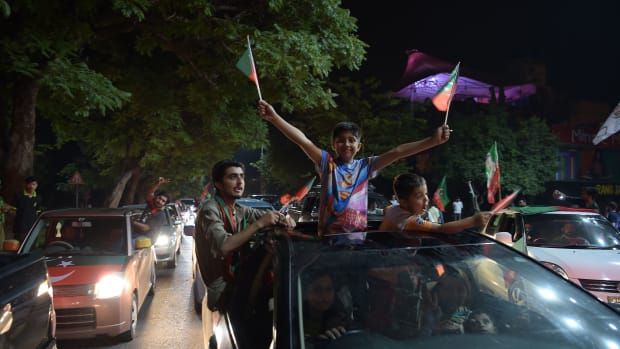 "Supporters of Pakistan's cricketer-turned politician Imran Khan, head of the Pakistan Tehreek-e-Insaf (Movement for Justice) Party, celebrate on a street during the general election in Islamabad on July 25th, 2018. Pakistan's incumbent party rejected early election results Thursday that suggested Khan was on his way to becoming the country's next prime minister, alleging ""blatant"" rigging."