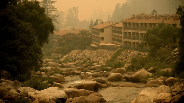Smoke from the Ferguson fire hangs over the Yosemite View Lodge in El Portal, Yosemite National Park, California, on July 21st, 2018.