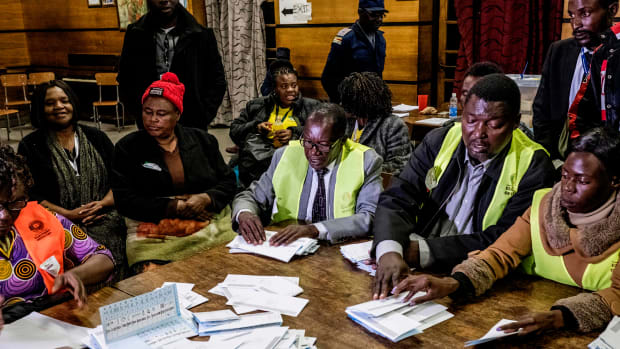 Election officials tally presidential candidates' ballots during counting operations for Zimbabwe's general election at the David Livingston primary school in central Harare on July 30th, 2018. Voting closed in Zimbabwe's first election since the former president was ousted after 37 years in power as observers warned of possible shortcomings in July 30th's landmark poll.