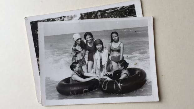 The author's mother, crouching in the center, with women she befriended at the Songkhla refugee camp.