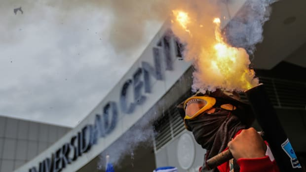 A student fires a homemade mortar during a protest in which students from different universities from across Nicaragua gathered to demand President Daniel Ortega and his powerful vice president, wife Rosario Murillo, resign, and for government to keep the 6 percent budget for universities, in Managua, on August 2nd, 2018.