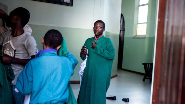 Altar boys prepare ahead of the Sunday Mass celebration at the Sacred Heart Church in Harare, Zimbabwe, on August 5th, 2018. Zimbabweans went to church for the first time since contested elections and post-poll violence shook the country, with clergymen leading prayers for peace.