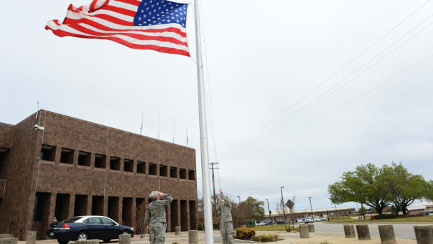 20th Fighter Wing Airmen lower the flag to half-mast at Shaw Air Force Base, S.C., April 5th, 2013. Capt. James Steel, 77th Fighter Squadron chief of mobility, was killed in the line of duty April 3th, after his aircraft crashed in Afghanistan returning to base from a close air support mission.