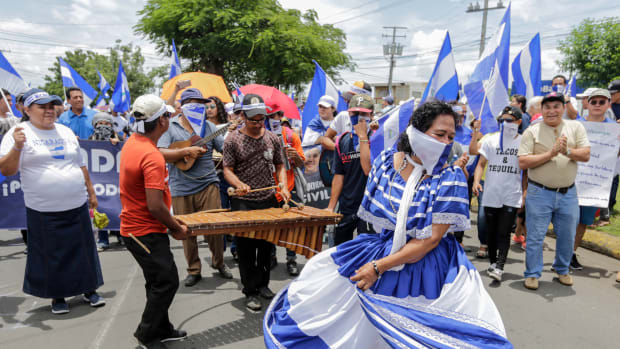 Anti-government protesters play traditional music and dance as they take part in a march demanding the release of political prisoners in Managua, Nicaragua, on August 15th, 2018.