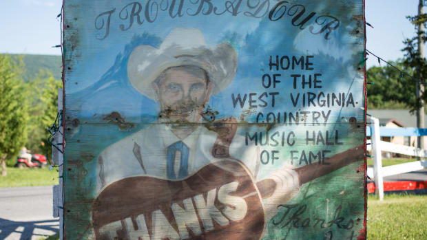 A sign outside the Troubador, a honky-tonk in Winchester, Virginia.