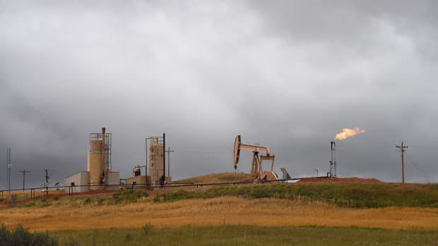 Pump jacks and a gas flare are seen near Williston, North Dakota, on September 6th, 2016.