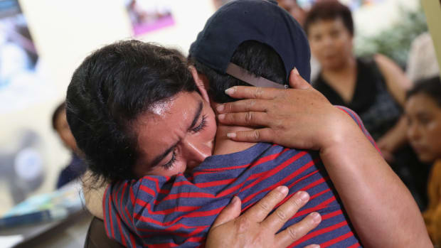 Isidra Larena Calderon hugs her son Jonathan Leonardo on August 7th, 2018 in Guatemala City, Guatemala, as the two are reunited months after U.S. border agents separated them.