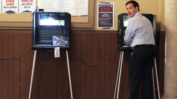Marco Rubio stands at a voting machine on August 24th, 2010, in Miami, Florida.