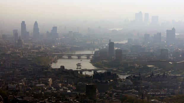 Air pollution hangs over the heart of London in this view along the River Thames.