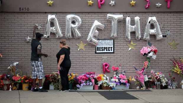 People prepare a makeshift memorial as fans gather for a final public viewing of the late soul singer's remains on August 30th, 2018, in Detroit, Michigan.