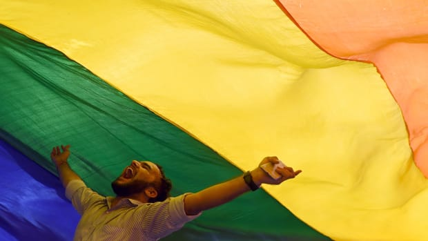 A member of the LGBT community celebrates the Supreme Court's decision to strike down a colonial-era ban on gay sex in Mumbai, India, on September 6th, 2018. In a landmark victory, the ruling overturned the ban, which had been at the center of years of legal battles for gay rights advocates.