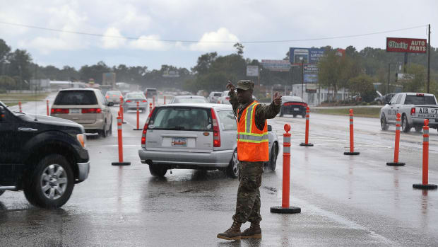 Traequan Shaw of the South Carolina National Guard directs traffic onto U.S. 501 in Myrtle Beach after the South Carolina government ordered that traffic use all the lanes on the route leading away from the coast to facilitate evacuation ahead of the arrival of Hurricane Florence on September 11th, 2018.