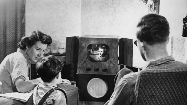 A family watching television at home, circa 1955.