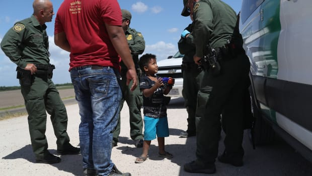 A boy is taken into custody by U.S. Border Patrol agents near the U.S.-Mexico Border on June 12th, 2018, near Mission, Texas.