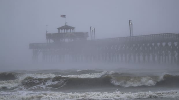 Waves created by Hurricane Florence are seen along Cherry Grove Fishing Pier on September 14th, 2018, in North Myrtle Beach, South Carolina.