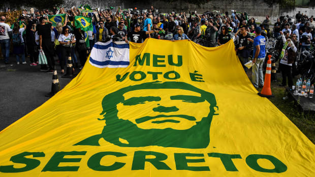 "Supporters of Brazilian right-wing presidential candidate Jair Bolsonaro display a banner reading ""My Vote Is Secret"" as they gather in front of the Israelita Albert Einstein Hospital in Sao Paulo, Brazil."