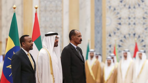 Abu Dhabi's Crown Prince Sheikh Mohamed bin Zayed Al Nahyan (C) receives Ethiopian Prime Minister Abiy Ahmed (L) and Eritrean President Isaias Afwerki (R) at the presidential palace in the United Arab Emirates capital of Abu Dhabi on July 24th, 2018.