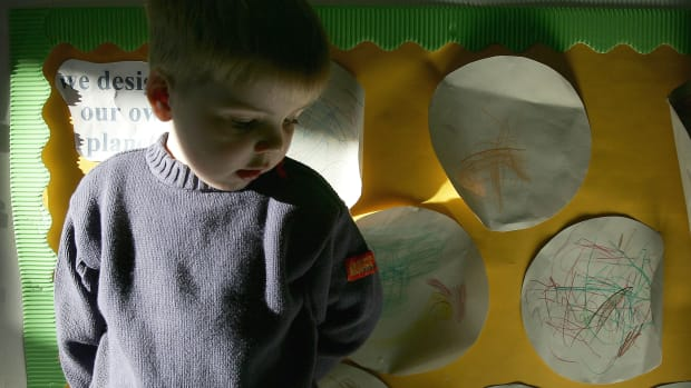 A three-year-old boy attends a private nursery school January 28, 2005 in Glasgow, Scotland.