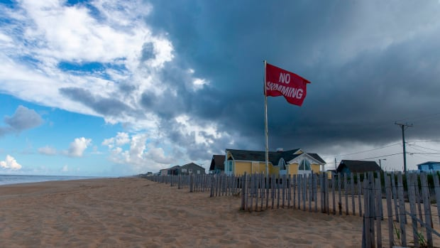 A No Swimming flag flies on the beach in Kill Devil Hills in the Outer Banks of North Carolina.