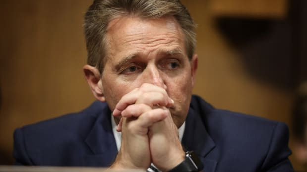 Senator Jeff Flake listens to Democratic senators speak during a Senate Judiciary Committee meeting on September 28th, 2018, in Washington, D.C.