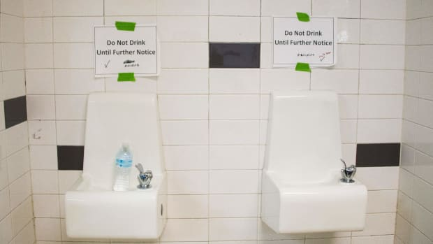 Placards warn against drinking from the water fountains at Flint Northwestern High School in Flint, Michigan, on May 4th, 2016.