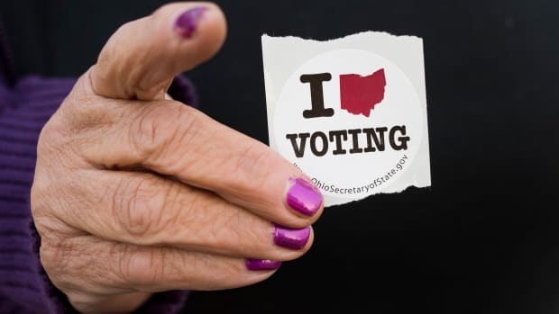 A woman holds her voting sticker in her hand after casting her ballot in Leetonia, Ohio.