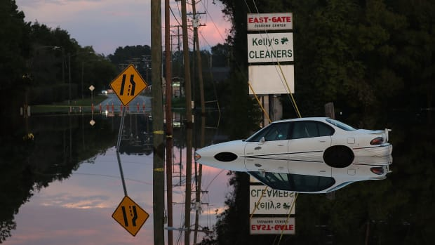 A car sits in a flooded parking lot on September 18th, 2018, in Fayetteville, North Carolina.
