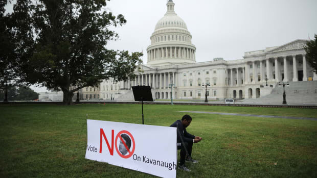 A student waits for fellow demonstrators for a rally on the U.S. Capitol East Lawn to protest the confirmation of Brett Kavanaugh on October 6th, 2018, in Washington, D.C.