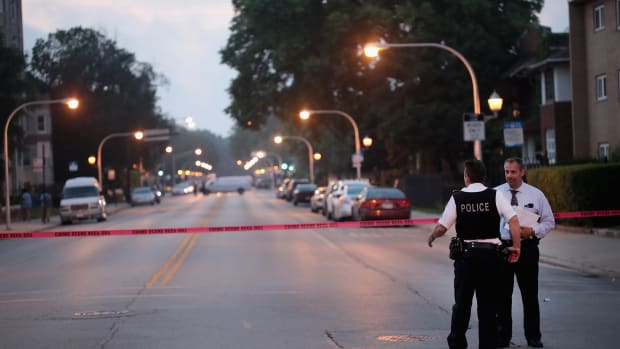 Police investigate a scene where two people were shot on July 16th, 2018, in Chicago, Illinois.