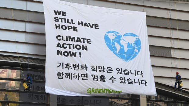 Greenpeace activists display a banner at a rally during a meeting of the Intergovernmental Panel for Climate Change in Incheon, South Korea, on October 8th, 2018.