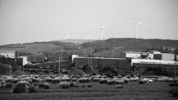 A wind farm looms over the coal washery at Onllwyn, Wales.