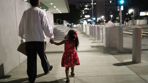 Shortly after he was released on bond from six months in ICE custody, a Honduran man walks with his daughter near Metropolitan Detention Center on October 2nd, 2018, in Los Angeles, California.