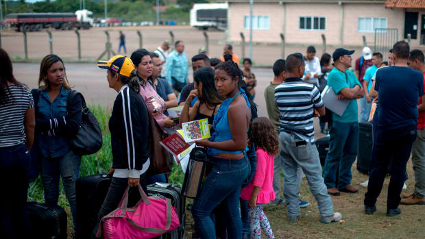 Venezuelans wait in a queue in front of the Brazil Federal Police Office in the Venezuela-Brazil border, at Pacaraima, Roraima, Brazil, on February 28th, 2018. According to local authorities, around 1,000 refugees are crossing the Brazilian border each day from Venezuela.