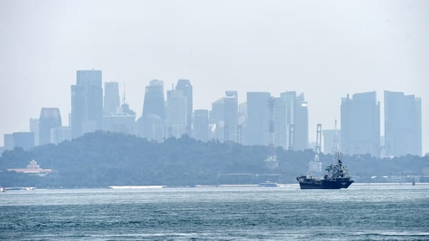 A general view of hazy Singapore skyline is seen from the southern straits of Singapore on September 14th, 2017.