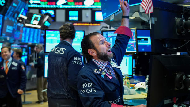 Traders work at the opening bell on the floor of the New York Stock Exchange on October 12th, 2018, in New York City. The Dow Jones Industrial Average jumped over 400 points at Friday's open, following two days of steep losses.