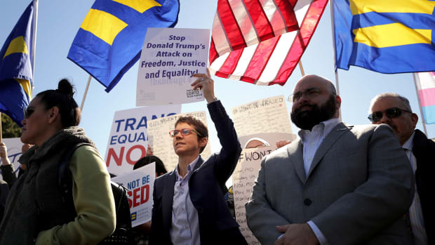 "LGBTQ activists from the National Center for Transgender Equality, partner organizations, and their supporters hold a ""We Will Not Be Erased"" rally in front of the White House on October 22nd, 2018, in Washington, D.C. Members of the LGBTQ community and their supporters across the country mobilized quickly to show support for transgender rights after the New York Times published news of an unreleased Trump administration memo that proposes a strict definition of gender based on a person's genitalia at birth."