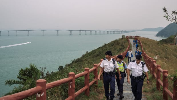 Police patrol ahead of Chinese President Xi Jinping's arrival for the official opening of the world's longest sea bridge on October 23rd, 2018, in Hong Kong. The bridge, which spans 34 miles, links Hong Kong, Macau, and Zhuhai on China''s southern coast of Guangdong province, is set to open this week as part of Beijing''s plan to merge 11 cities in its southern region into one megalopolis. Critics warn the bridge will increase China's influence over semi-autonomous Hong Kong.