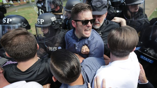 "White nationalist Richard Spencer and his supporters clash with Virginia State Police in Emancipation Park after the ""Unite the Right"" rally was declared an unlawful gathering August 12th, 2017, in Charlottesville, Virginia."