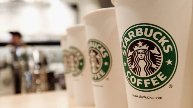 Beverage cups featuring the logo of Starbucks Coffee are seen in the new flagship store on 42nd Street August 5, 2003 in New York City. The Seattle-based coffee company has emerged as the largest food chain in the Manhattan borough of New York with 150 outlets.