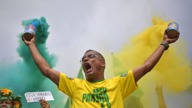 A supporter of far-right lawmaker and presidential candidate for the Social Liberal Party Jair Bolsonaro takes part in a pro-Bolsonaro demonstration in Rio de Janeiro, Brazil, during the second round of the presidential elections on October 28th, 2018.
