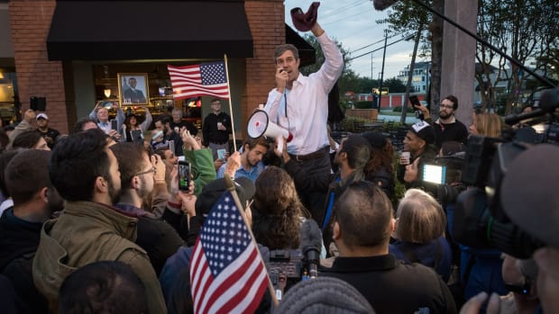 Democratic Senate candidate Beto O'Rourke addresses supporters near a polling place on the first day of early voting on October 22nd, 2018, in Houston, Texas.