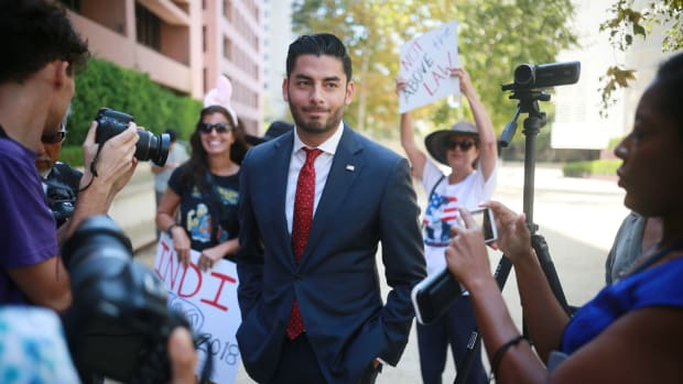 Ammar Campa-Najjar, who is running against Congressman Duncan Hunter, speaks to reporters outside the San Diego Federal Courthouse during Congressman Hunter's arraignment hearing on Thursday, August 23rd, 2018 in San Diego, California.
