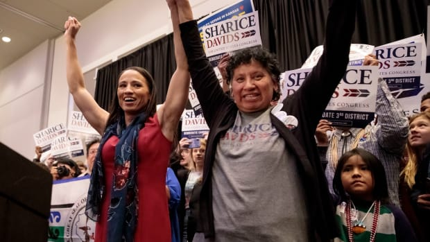 Democratic candidate for Kansas' 3rd Congressional District Sharice Davids (L) and her mother, Crystal Herriage, celebrate with supporters during an election night party on November 6th, 2018, in Olathe, Kansas. Davids defeated incumbent Republican Kevin Yoder. Davids and Deb Haaland (D-New Mexico) will become the first Native American women to serve in Congress.