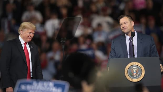 Republican candidate for governor of Kansas Kris Kobach, who lost his race on Tuesday, speaks at a rally with President Donald Trump at the Kansas Expocenter on October 6th, 2018, in Topeka, Kansas.