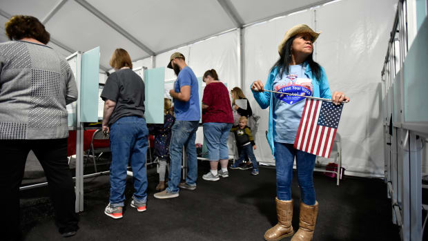 Election worker Leah Barney (right) watches over voters as they cast their ballots on November 6th, 2018, in Las Vegas, Nevada.