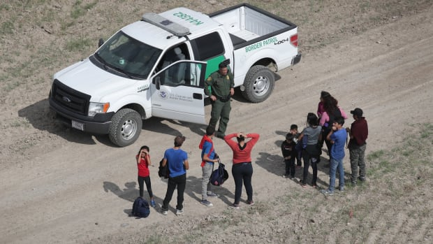 Asylum seekers turn themselves in to a U.S. Border Patrol agent after crossing from Mexico into the United States on November 7th, 2018, in Mission, Texas.