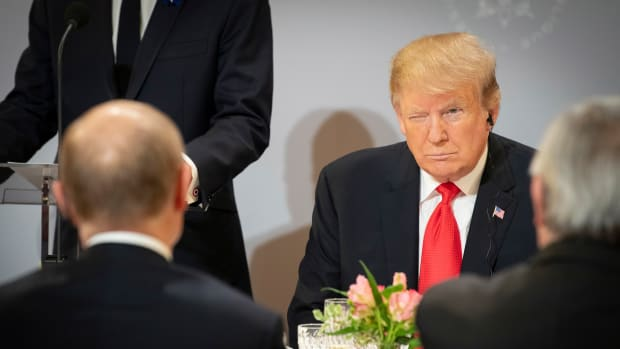 President Donald Trump sits opposite Russian President Vladimir Putin during lunch at the Elysée Palace while commemorating the 100th anniversary of the end of World War I, November 11th, 2018, in Paris, France.